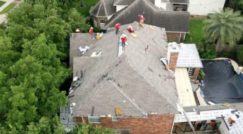 Local Cypress roofing company replaces old worn out roof with new Weathered Wood GAF TImberline HDZ shingles